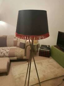 Tall lamp with black shade