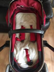 Red mothercare orb pushchair and carry cot
