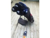 DUNLOP, 3 WOODS, SET OF IRONS 9 8 7 6 5 4 3, PW, PUTTER, HIPPO BAG ON STAND, GOLF BALLS, TEES, GLOVE