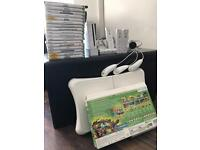 Wii console with games & wii fit board