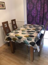 Solid oak extendable dinning table and 4 chairs in nearly new condition