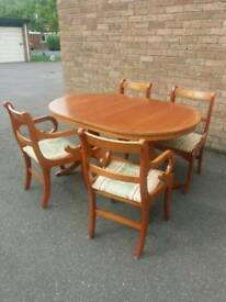 Wooden dinner table and 4 chairs