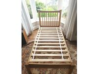 Single solid wood bed frame.