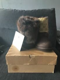 Real uggs size 5 bra and new never been worn