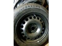 "New 15"" tire on wheel"