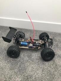 Remote control 1/10 electric powered off road truggy with extras