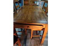 Solid oak extendable kitchen table with 6 x matching chairs faux leather seat