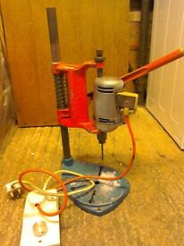 Bench drill and two electric drills.