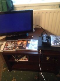 It's a PS3 super slim 500gb with 5 games works perfectly