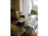 Glass dining table with 4 cream designer chairs reduced