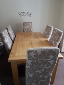 Solid wood extendable table and fabric chairs