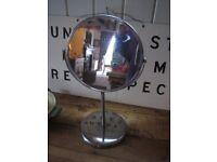 Ikea bathroom mirror. Circular chrome swivel style on stand.