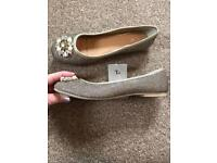 New Gold flat shoes size 4.