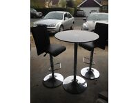 Tall bistro table with stools