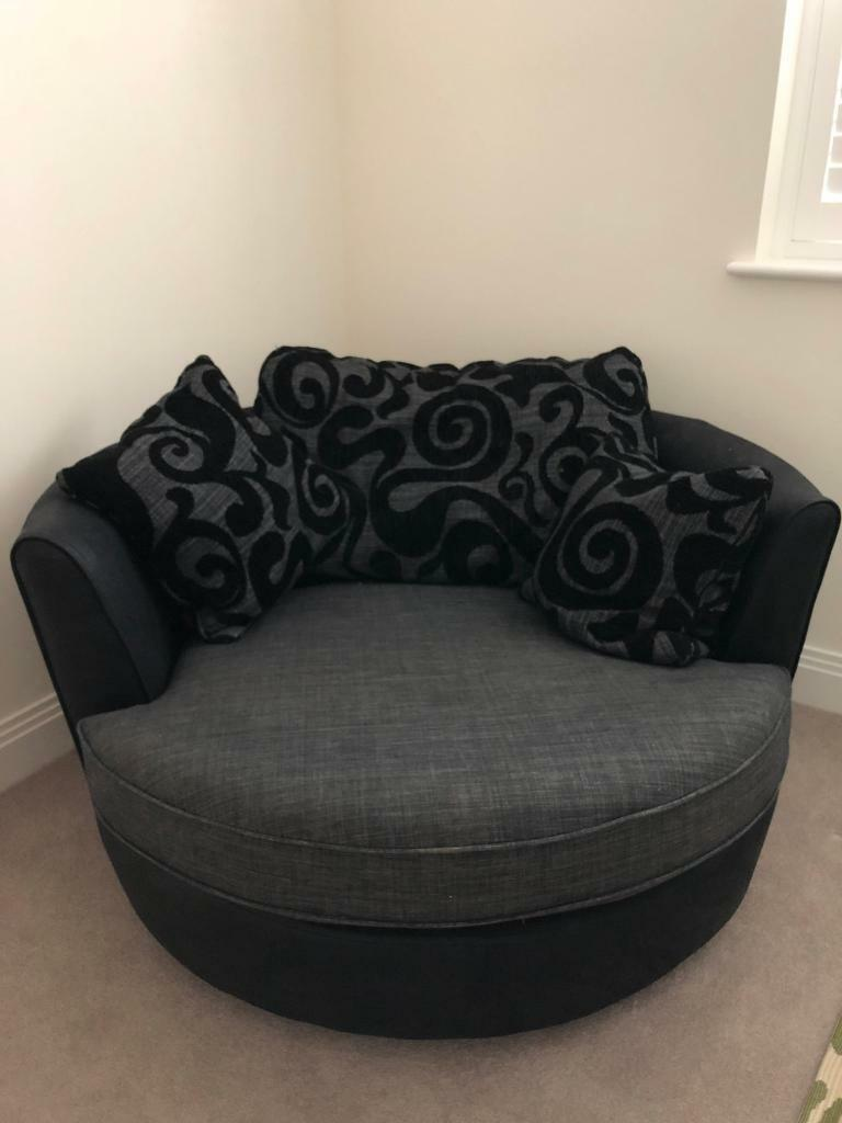 large swivel round cuddle chair fabric grey black in warfield