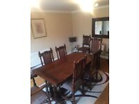 Solid oak extending dining table with 8 chairs. Beautiful condition.