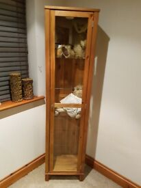 Pine coloured display cabinet/unit.