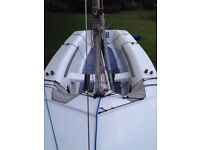 Cadet Dinghy sail number 9668. Road and launch trailer.
