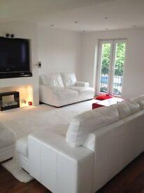 2 x White leather 2 seater sofas
