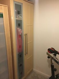 Immaculate wooden wardrobe with glass door