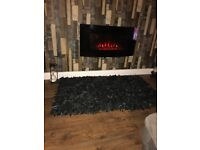 Wall mounted electric fire. Remote control settings Excellent condition. Brackets included
