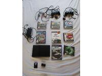 Playstation PS2 Slim plus 8 Games