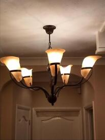 A pair of 5 Lamp copper and Glass Chandeliers