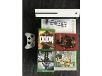 Xbox one s with media Remote Control, baterry pack and games