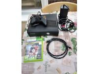 xbox 360 with 1 controller and 1 game