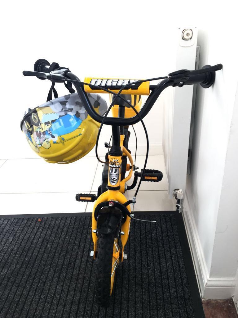 12 inch boys bike and helmet