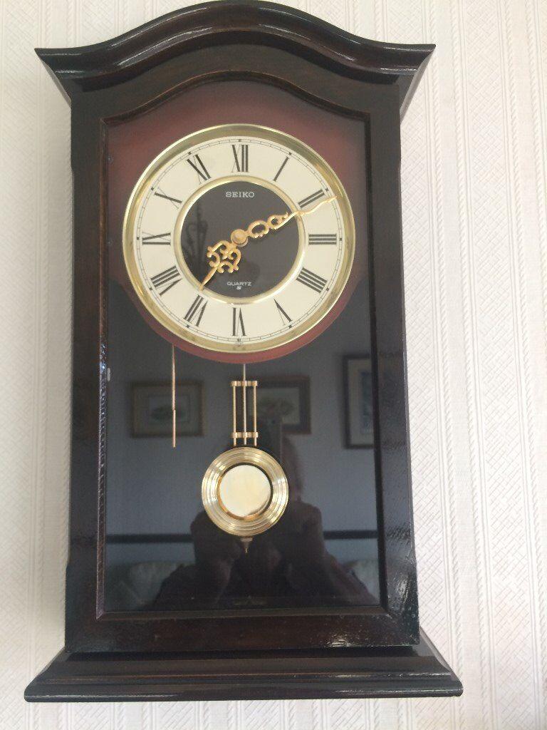 Traditional Dark Wood Wall Clock In Horbury West
