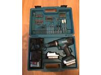 Makita combi drill driver with 2 batterys charger and bits