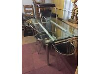 extendable glass dining table and four chairs