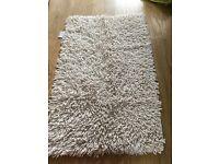 Cream bath mat