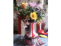 vase with artificial flowers only asking 7pound o.n.o