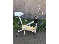 Vintage exercise bike by universal