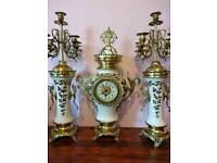 Antique porcelain and solid brass clock set