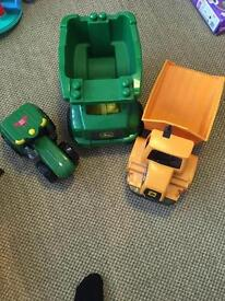 Dump trucks and tractor