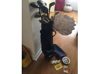 WILSON GOLF BAG AND CLUBS/PUTTERS - USED OFFERED FOR A QUICK SALE