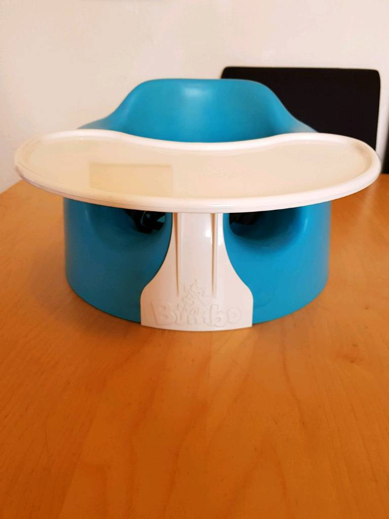 Blue Bumbo seat with play tray and straps