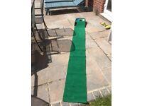 Brand Fusion golf putting mat with ball return