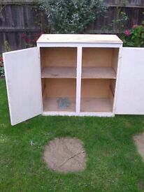 Cupboad for storage in garage or garden shed. Two doors one shelf