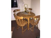 Small wooden dining table and chairs(4)