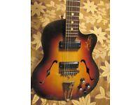 Vintage electro-acoustic guitar