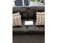 Large 2 seater black leather sofa