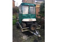 EZGO golf buggy petrol with galvanized trailer can deliver