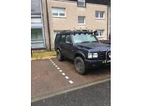 W red 2.5 4x4 land rover discovery
