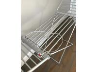 Heated drying rack for fast collection