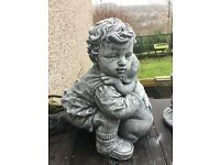 Large stone boy holding dog stone garden ornament