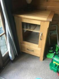 solid wood hifi cabinet. Framed glasss door and draw